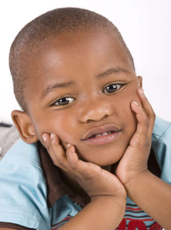 ethnic people: Adorable 3 year old black or African American boy with his hands on his chin  Stock Photo