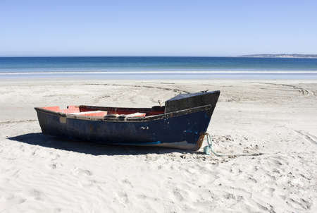 west coast: Boat on a secluded beach in Paternoster, South Africa Stock Photo