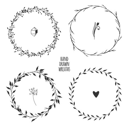 Set of four hand drawn floral wreaths for spring design isolated on white. Vector illustration.