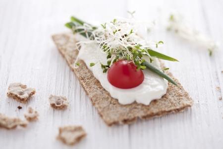 chive: crisp bread sandwich with cream cheese, broccoli sprouts, tomato and chive