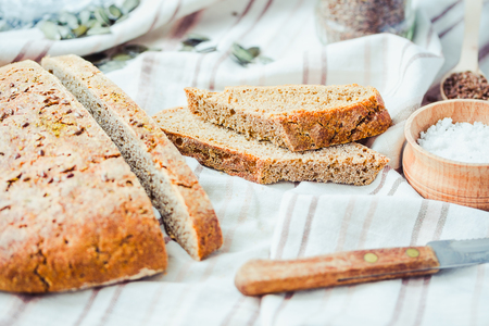 organic flax seed: homemade rye bread unleavened with flax seed and pumpkin slices, healthy organic food