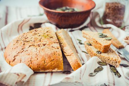 organic flax seed: homemade rye bread unleavened with flax seed and pumpkin slices, yeast free, healthy organic food