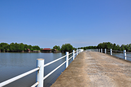 Wooden bridge across the sea at chunthaburi Province, Asia thailand  photo