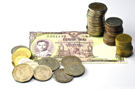Thailands currency and olded, the baht coins.  photo