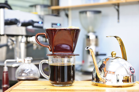 making coffee using Cup of coffee filter and Kettle Standard-Bild
