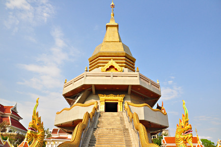 stair well: Naka statue on staircase balustrade at Thai Buddhist pagoda, Udonthani province, Thailand