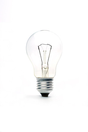 retraining: vintage lighted bulb  isolated on white background