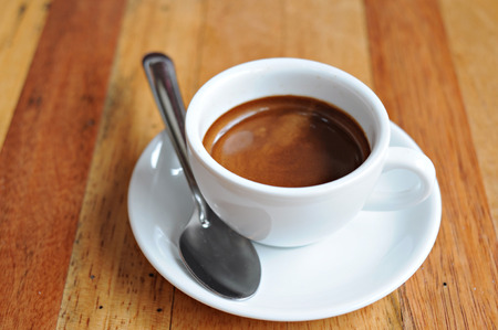 hot coffee ristretto in cup on wooden table Standard-Bild