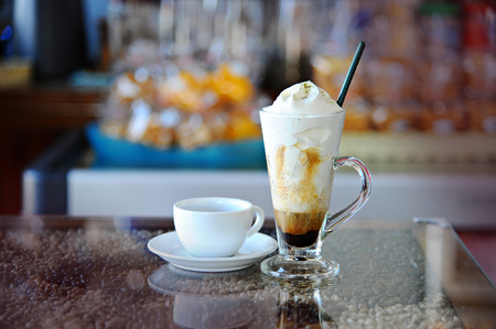 hot coffees: Fresh hot Coffee And Whipping Cream in Glass (Still Life)