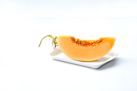 abject: Cantaloupe Melons on Plate