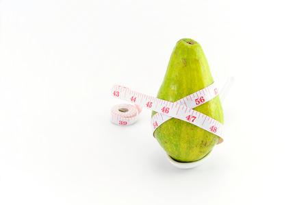 measuring tape: Avocado and Measuring Tape Representing diet Stock Photo