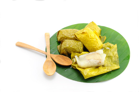 mush: Thai Sweets bunch of mush with banana filling on banana leaf, white background