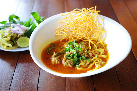 food dish: Thai Food Name is Khao Sawy, Northern Thai Noodle Curry Soup