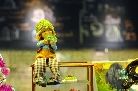 depend: The boy doll sit in coffee cafe