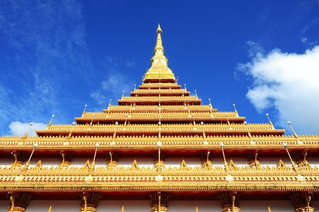 stair well: Golden pagoda at Wat Nong Wang temple and blue sky, Khonkaen Thailand Stock Photo