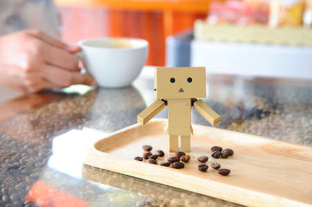 editorial design: Danboard or Danbo and Coffee beans Stock Photo