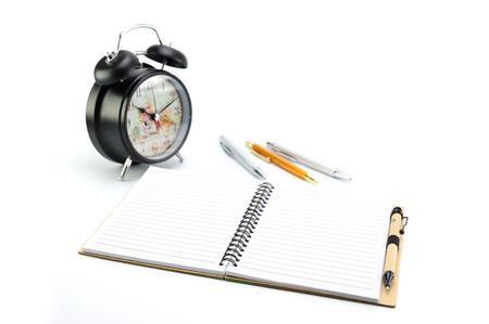 books, alarm clock and pen on white background Stock Photo