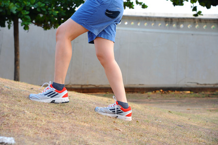 woman legs walking in the pathway exercise. (style still life)