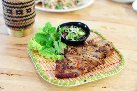 Slides Herbal Roast Pork placed on the plate (Thai food)