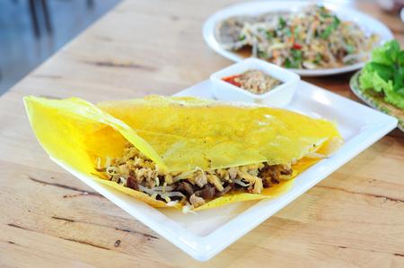 Vietname cuisine, Vietnamese stuffed crispy omelette on wood table