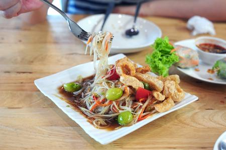 Pickled crab salad or Papaya salad (Som tum), Thailand