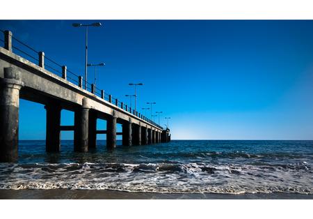 Bridge on the Atlantic Ocean in a sunny day photo