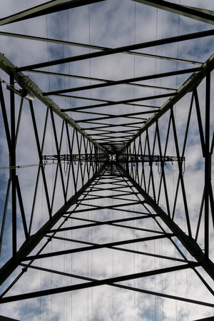 underneath: high voltage power line from underneath in Elbe river Stock Photo