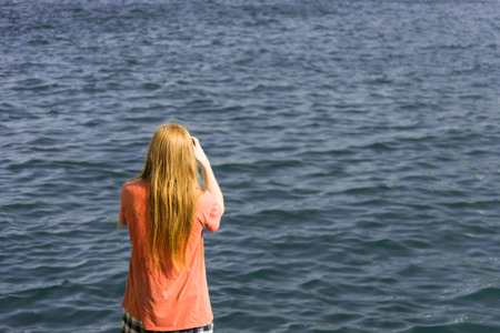 dishevelled: Redhead Man Back takes Pictures of Ocean standing on Pier