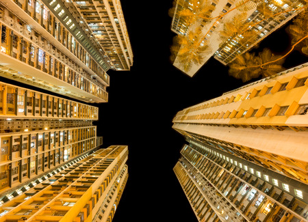 overcrowded: Overcrowded Apartment at Night in a district of Hong Kong Stock Photo