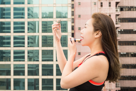 lip stick: Red lips on a Rooftop in Hong Kong Island