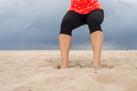 girl fitness: Feet of a sporty Woman in the Beach