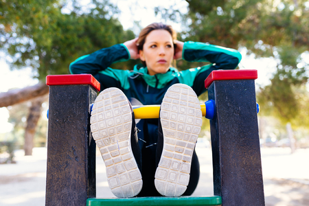 crunch: Woman doing Crunch in a Park in a Park Stock Photo