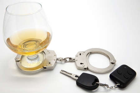 sobriety: Alcohol, Handcuffs and Keys  - Drunk Driving Concept