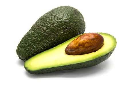 two object: One whole and one sliced avocado on white isolated background