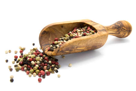 peppar: Mixed color pepper in wooden scoop on white isolated background