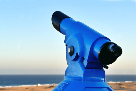 Binoculars - Telescope - on the beach - laterally from the left