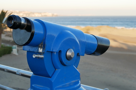 Binoculars - Telescope - on the beach - laterally from the right Stock Photo