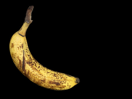 Banana fully ripe, overripe-black background-spots Banco de Imagens