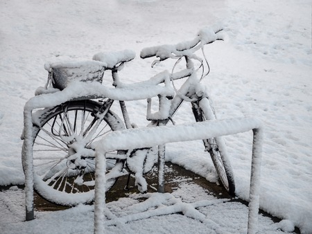 0615 Bike at bike rack, snowed, covered in snow