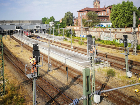 LUEBECK, GERMANY - August 03, 2018 - Repair of the overhead line at the main station in Lubeck, Germany. View from the station bridge