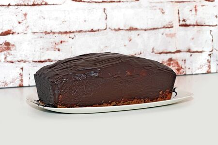 Sponge cake, pot cake or also called box cake with chocolate sauce. Reklamní fotografie