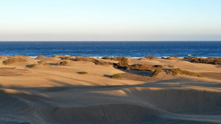 Tourists on the beach and the dunes of Maspalomas..