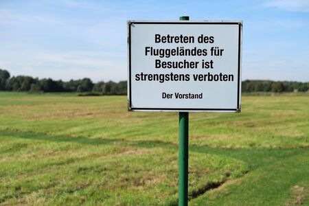 Information sign, entering model airfield prohibited. Stock Photo