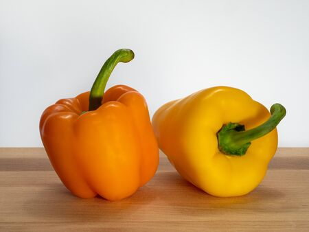 Paprika (Capsicum) yellow and orange peppers.