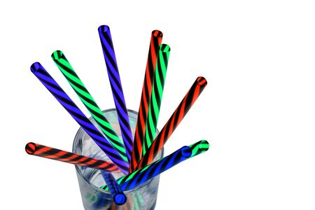Neon colored plastic drinking straws placed in a glass.jpg