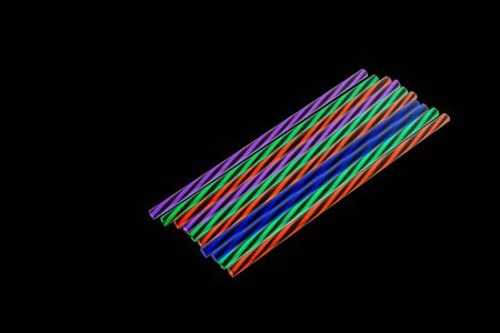 Colourly neon striped plastic drinking straws Stock fotó