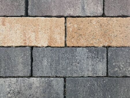 Bricks, paving stones, stacked as a wall, as a background. Stock Photo