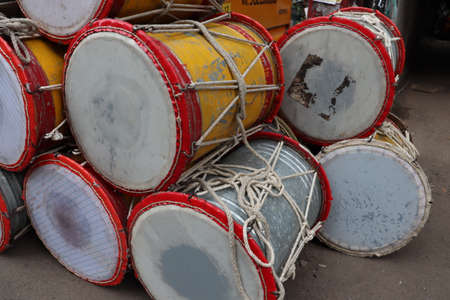 Big traditional indian drums used as a musical instrument. Drums are used during festivals to creat drum beats for all kinds of cultural and recreation activities. Maharastra and punjab carnival. Stok Fotoğraf