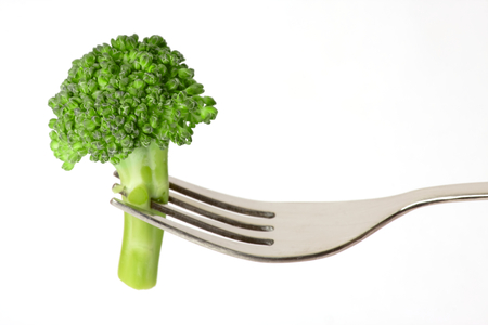 Healthy Eating - Broccoli on Fork isolated on white background 스톡 콘텐츠