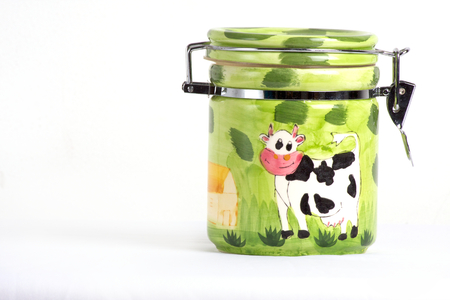 Green hand painted jar isolated on white background photo